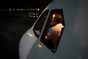 The captain of a Sri Lankan Airlines A340-300 series Airbus prepares his aircraft for departure to Colombo.