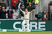 Wicket - Steve Smith of Australia is out for 211 off the bowling of Joe Root of England and he raises his arms and bat as he leaves the field during the International Test Match 2019, fourth test, day two match between England and Australia at Old Trafford, Manchester, England on 5 September 2019.