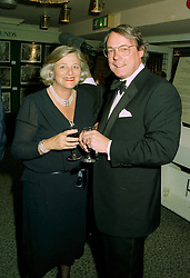 MRS VIVIEN DUFFIELD the multi millionaire arts benefactor and MR PAUL DUPEE, at a reception in London on 12th June 1997.LZH 76