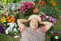Senior Woman Relaxing in Garden