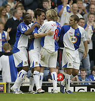 Photo: Aidan Ellis.<br /> Blackburn Rovers v Manchester City. The Barclays Premiership. 17/09/2006.<br /> Rovers Morten Gamst Pedersen is mobbed after scoring the second goal