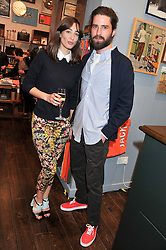TV presenter LAURA JACKSON and JACK GUINNESS at the opening of the new Jack Spade store at 83 Brewer street, London on 29th March 2012.