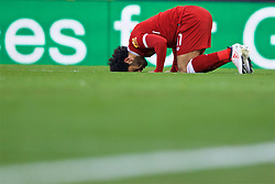 LIVERPOOL, ENGLAND - Saturday, February 24, 2018: Liverpool's Mohamed Salah prays as he celebrates scoring the second goal during the FA Premier League match between Liverpool FC and West Ham United FC at Anfield. (Pic by David Rawcliffe/Propaganda)