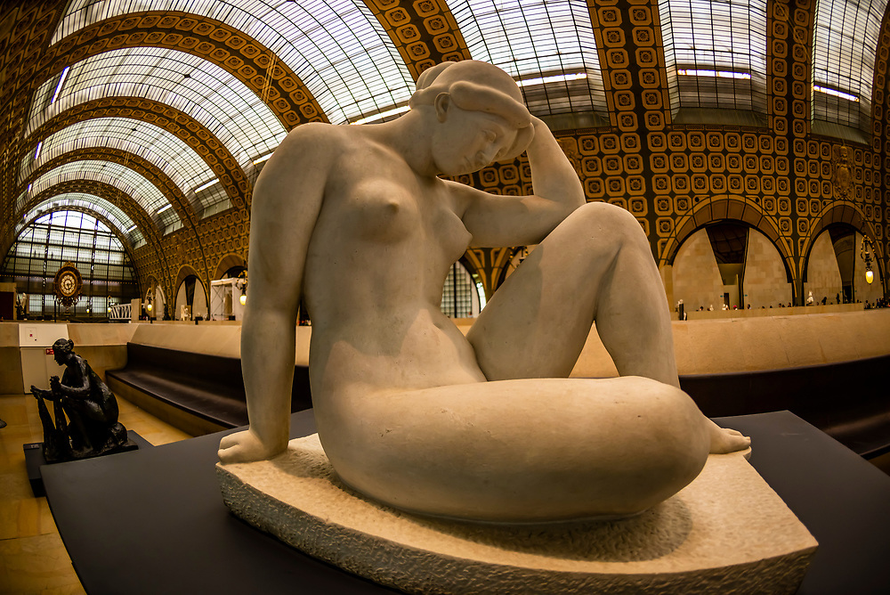 """La Méditerrannée, a nude sculpture by Aristide Maillol, Musee d""""Orsay,  a museum in Paris, France, on the Left Bank of the Seine. It is housed in the former Gare d'Orsay, a Beaux-Arts railway station built between 1898 and 1900."""