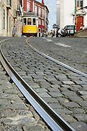 Traditional yellow tram at Alfama quarter