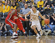 WICHITA, KS - NOVEMBER 12:  Guard Fred VanVleet #23 of the Wichita State Shockers dribbles against forward Aaron Adeoye #11 of the Western Kentucky Hilltoppers during the second half on November 12, 2013 at Charles Koch Arena in Wichita, Kansas.  (Photo by Peter Aiken/Getty Images) *** Local Caption *** Fred VanVleet;Aaron Adeoye