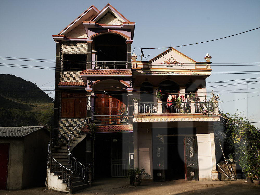Fancy exteriors of homes nestled in the mountainous province of Ha Giang, Vietnam, Southeast Asia