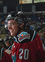 KELOWNA, CANADA - SEPTEMBER 20: Austin Glover #20 of Kelowna Rockets smiles on the bench after scoring a goal in the first period against the Kamloops Blazers on September 20, 2014 at Prospera Place in Kelowna, British Columbia, Canada.   (Photo by Marissa Baecker/Shoot the Breeze)  *** Local Caption ***Austin Glover;