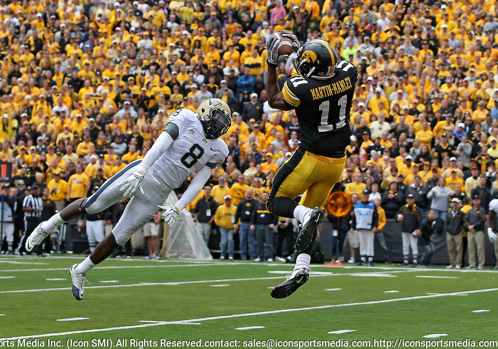 September 17, 2011: Pittsburgh Panthers linebacker Todd Thomas (8) can't quite reach the ball as Iowa Hawkeyes wide receiver Kevonte Martin-Manley (11) pulls in the game winning 22 yard touchdown pass during the second half of the game between the Iowa Hawkeyes and the Pittsburgh Panthers at Kinnick Stadium in Iowa City, Iowa on Saturday, September 17, 2011. Iowa defeated Pittsburgh 31-27.