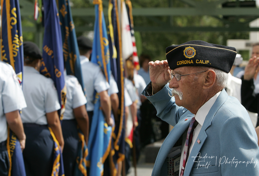 /Andrew Foulk/ For the Californian/.Air Force Veteran of the World War II Jules Welker, salutes the flag as it is brought out by Lake Elsinore High school R.O.T.C. members during the Lake Elsinore cemetery Memorial Day ceremony.