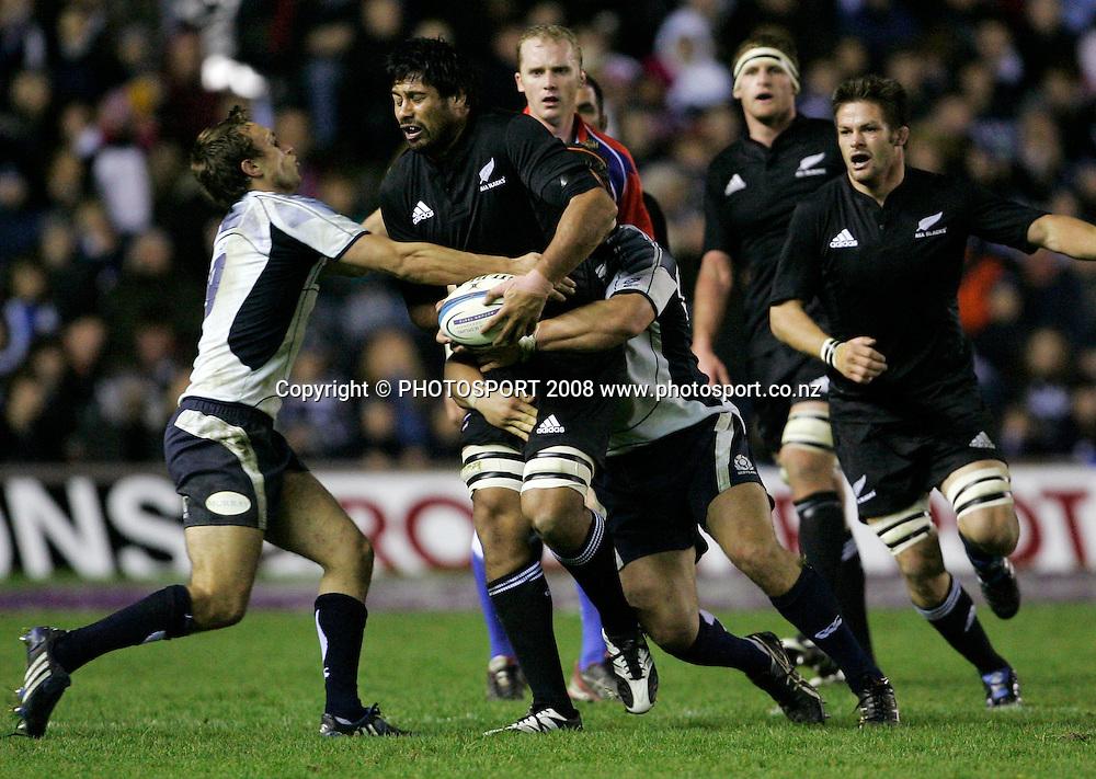 All Black Ross Filipo is tackled. Scotland vs New Zealand, Murrayfield Stadium, Edinburgh, Scotland. 8th November 2008. Photo: Tim Hales/PHOTOSPORT