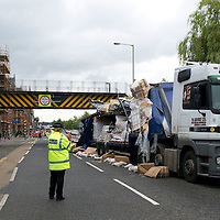 RTC on Tay Street, Perth.....19.07.10<br /> The remains of a lorry pictured on Tay Street in Perth after it collided with the railway bridge on the Perth to Dundee line ripping the roof of the lorry off and shedding its load. The road was closed as structural engineers checked the bridge.<br /> Picture by Graeme Hart.<br /> Copyright Perthshire Picture Agency<br /> Tel: 01738 623350  Mobile: 07990 594431