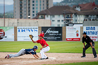 KELOWNA, BC - JULY 17: James Shimashita #8 of the Kelowna Falcons readies the catch as a player of the Wenatchee Applesox returns to first after leading off to steal second at Elks Stadium on July 17, 2019 in Kelowna, Canada. (Photo by Marissa Baecker/Shoot the Breeze)