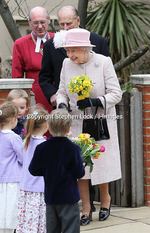 The Queen receives flowers from children as she leaves  the Easter Day service at St.George's Chapel, Windsor Castle, Sunday, 31st March 2013.  Photo by: Stephen Lock / i-Images