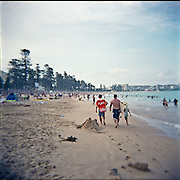 Picture taken with a Holga.People on Manly Beach during Australia Day.