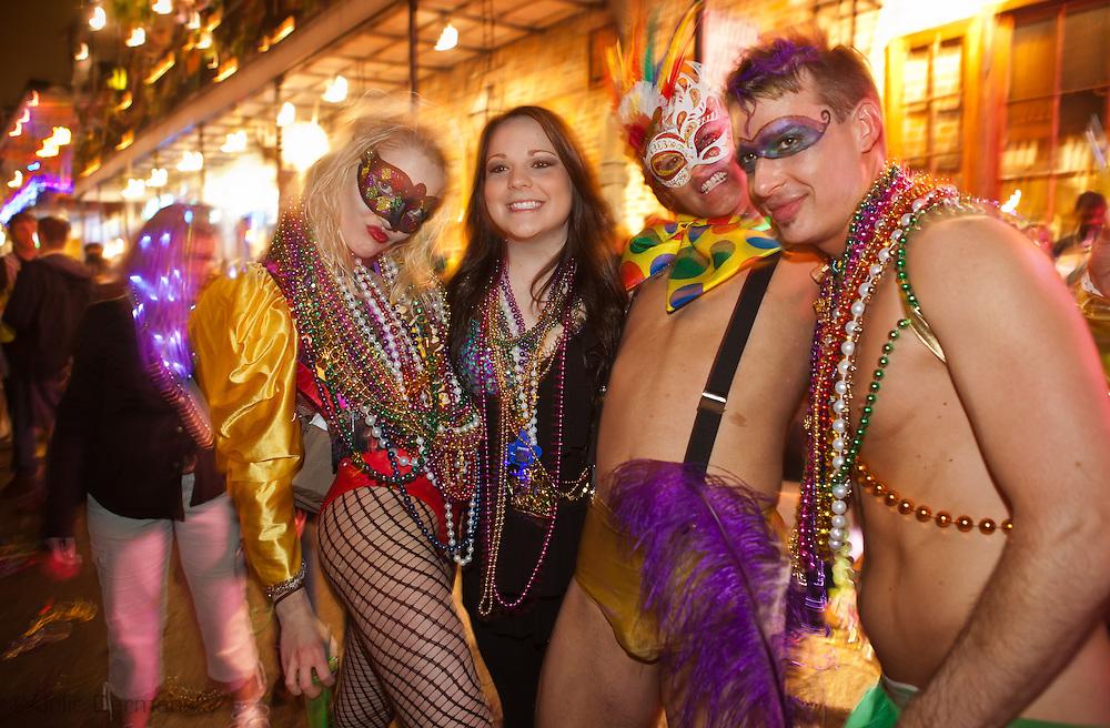 Mardi Gras 2011 in New Orleans . People celebrating Mardis Gras on Bourbon Street Mardi Gras night.