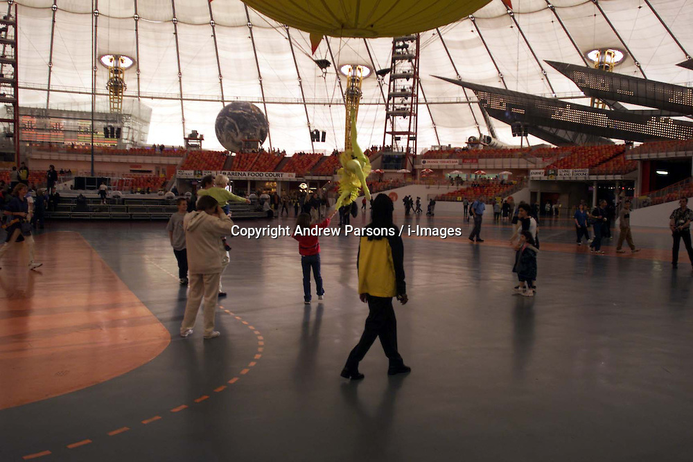 General Views of people enjoying themselves inside the Millennium Dome, United Kingdom, July 9, 2000. Photo by Andrew Parsons / i-Images.