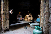 Workers sit and wait for power to be restored at a workshop in the 'Old City' sector of Lahore. ..Parts of Pakistan are reportedly suffering 12-20-hours of electricity load shedding (power outages) per day. Many industries are suffering as a result of not being ale to use production machinery during load shedding and are unable meet deadlines for manufacture and delivery of goods.