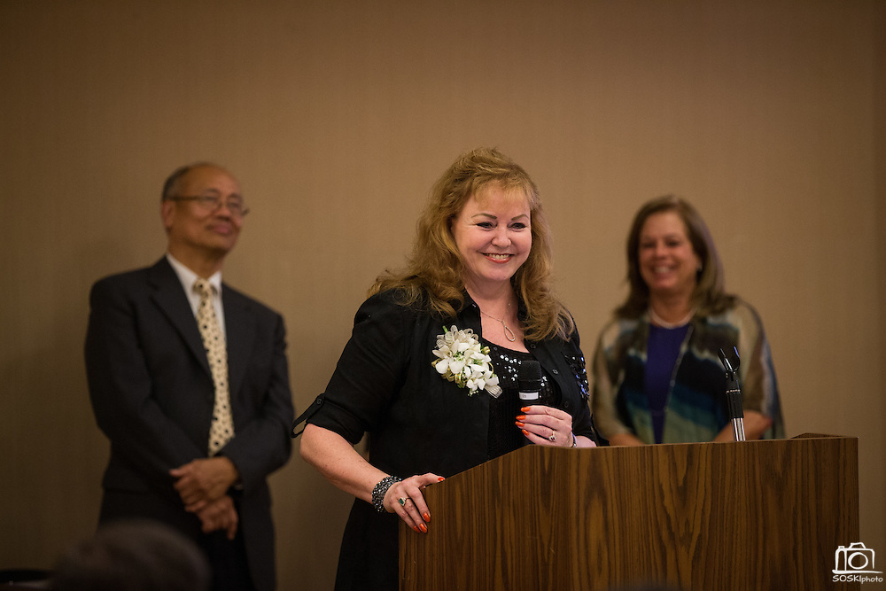 Kim Parker of Kim Parker Plantscapes Inc., presents after receiving Business Person of the Year during the Milpitas Chamber of Commerce 59th Annual Awards and Installation Banquet at Sheraton San Jose Hotel in Milpitas, California, on July 28, 2016. (Stan Olszewski/SOSKIphoto)