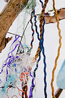 New York, Long Island - close-up of sculpture to show the colored string, flex, ribbons, plastic, etc.