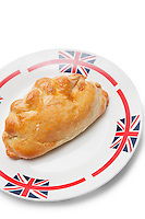 Fresh Cornish pastry in plate over white background