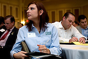 Katherine Hogan takes notes during Jeffrey Gitomer's lecture at the Ralph & Luci Schey Sales Symposium at Baker Center Thursday morning.