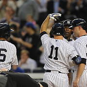 Brett Gardner, New York Yankees is congratulated at home plate after his second inning grand slam home during the New York Yankees V New York Mets, Subway Series game at Yankee Stadium, The Bronx, New York. 12th May 2014. Photo Tim Clayton