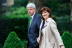 © Licensed to London News Pictures. 03/06/2014. LONDON, UK. Leader of the Commons Andrew Lansley (L) attending to a cabinet meeting in Downing Street on Tuesday, 3 June 2014. Photo credit: Tolga Akmen/LNP