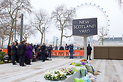 Mark Rowley<br /> (Assistant Commissioner for Specialist Operations in the Metropolitan Police Service) holds a press conference outside New Scotland Yard, London, Great Britain <br /> 24th March 2017 <br /> <br /> Acting Deputy Commissioner Mark Rowley gives a statement /  update on the ongoing counter terrorism investigation following the Westminster Terrorist attack. <br /> Floral tributes for PC Keith Palmer who was murdered by Khalid Masood during the attack. <br /> <br /> Photograph by Elliott Franks <br /> Image licensed to Elliott Franks Photography Services
