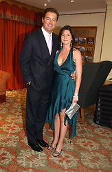 CHRISTIAN BEARMAN and NICOLA BECKWITH at '4 Inches' a project 'For Women about Women By Women' - A photographic Auction in aid of the Elton John Aids Foundation hosted by Tamara Mellon President of Jimmy Choo and Arnaud Bamberger MD of Cartier UK at Christie's, 8 King Street, London W1 on 25th May 2005.<br /><br />NON EXCLUSIVE - WORLD RIGHTS