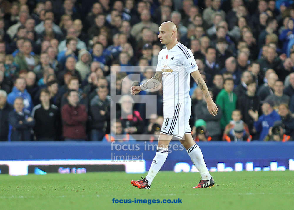 Jonjo Shelvey of Swansea City leaves the field after being sent off by referee Kevin Friend during the Barclays Premier League match against Everton, at Goodison Park, Liverpool.<br /> Picture by Michael Sedgwick/Focus Images Ltd +44 7900 363072<br /> 01/11/2014