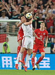 BUDAPEST, HUNGARY - Tuesday, June 11, 2019: Hungary's Ádám Szalai and Wales' captain Ashley Williams during the UEFA Euro 2020 Qualifying Group E match between Hungary and Wales at the Ferencváros Stadion. (Pic by David Rawcliffe/Propaganda)