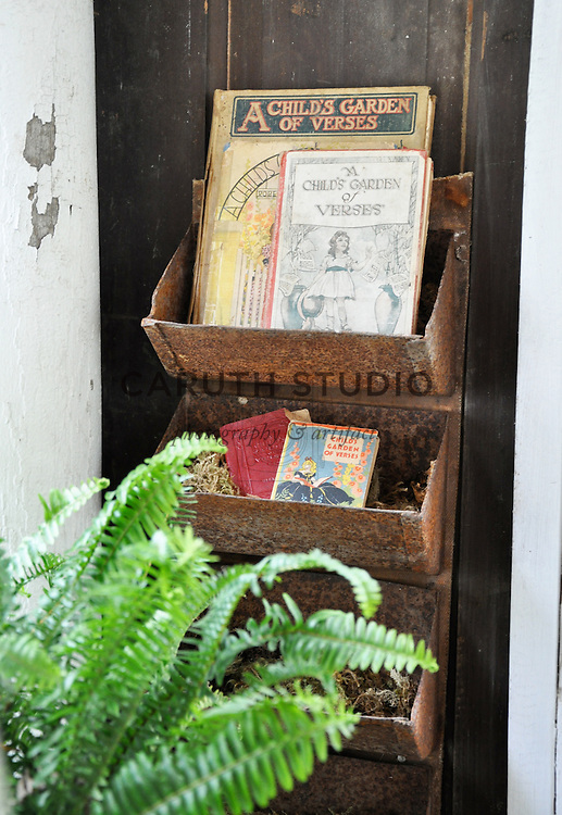 Architectural Salvage Shed: Vintage grain bins holding children's books