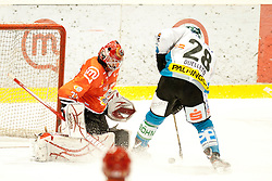 Fikrt Michael of HK Jesenice and Ouellette Mike of EHC Linz during ice-hockey match between HK Acroni Jesenice and EHC Liwest Black Wings Linz in 43rd Round of EBEL league, on Januar 17, 2012 at Dvorana Podmezaklja, Jesenice, Slovenia. (Photo By Urban Urbanc / Sportida)
