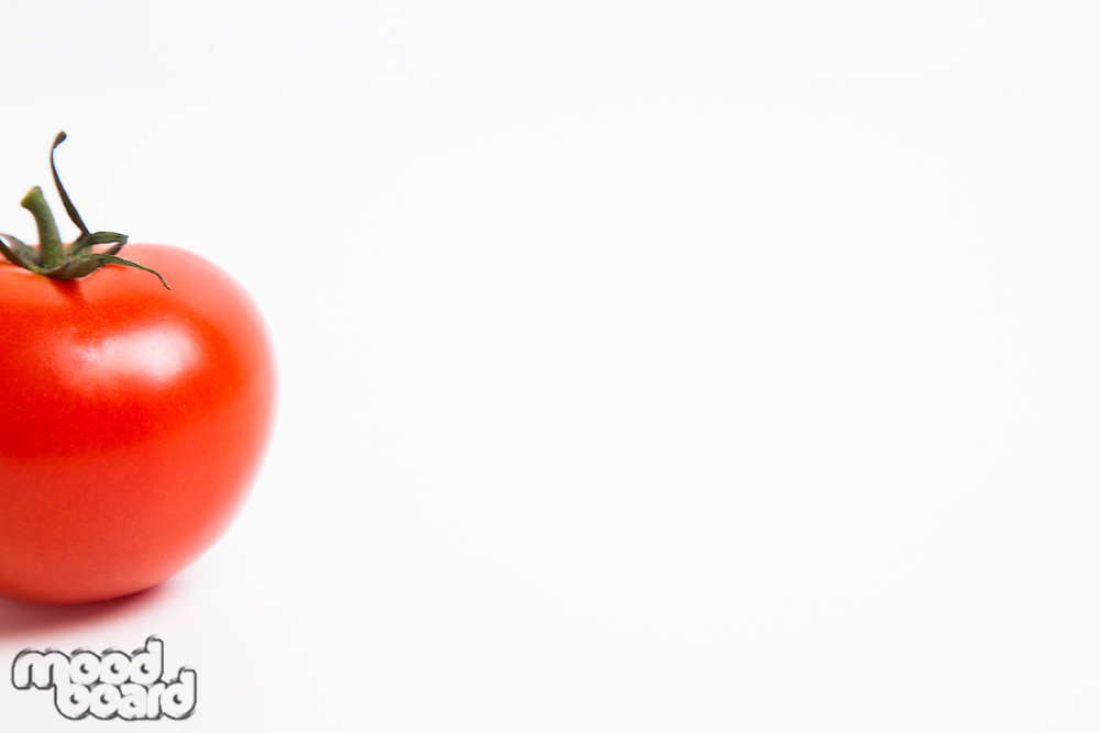 Cropped shot of tomato over white background