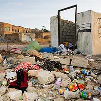 Garbage covering the ground near trash bin, Hawf Protected Area, Yemen