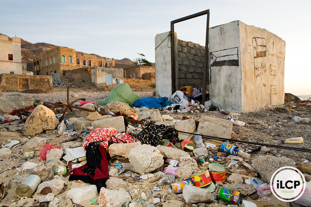 Garbage covering the ground near trash bin, Hawf Protected Area, Yemen