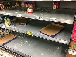 © Licensed to London News Pictures. 03/03/2020. London, UK. Empty shelves in the Home Bake aisle. Panic-buying starts to show in this ASDA store in Wandsworth as shelves empty out of goods. Earlier, Boris Johnson announced his battle plan in Downing Street for combating the coronavirus crisis. Photo credit: Alex Lentati/LNP