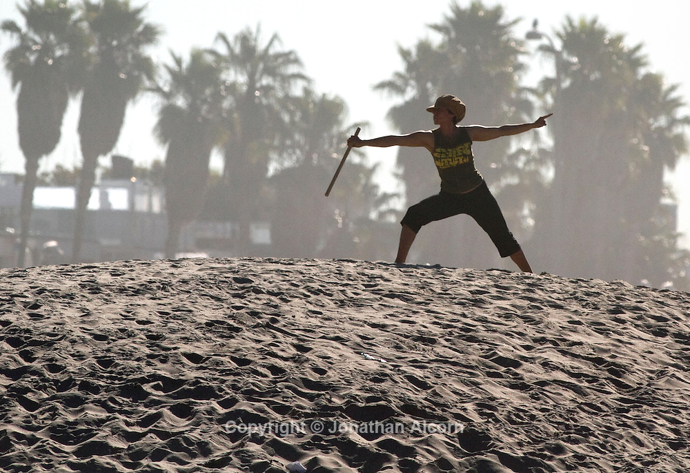 Tessa Cisneros practices Tai Chi during a morning workout on a sand berm in Venice in Venice Beach, California on February 9, 2012.©Jonathan Alcorn
