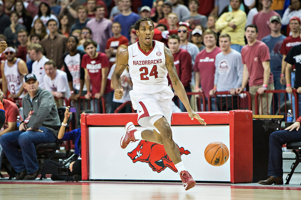 FAYETTEVILLE, AR - NOVEMBER 18:  Michael Qualls #24 of the Arkansas Razorbacks dribbles down the court against the SMU Mustangs at Bud Walton Arena on November 18, 2013 in Fayetteville, Arkansas.  The Razorbacks defeated the Mustangs 89-78.  (Photo by Wesley Hitt/Getty Images) *** Local Caption *** Michael Qualls