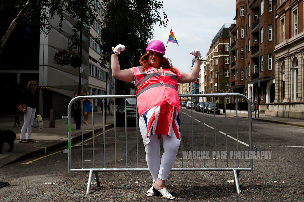 LONDON, UNITED KINGDOM - JUNE 29: A member of the LGBT community poses for a photo at the annual London Pride Parade, on June 29, 2013, in London, Untied Kingdom. The Pride Parade originated in 1971, with this years theme being Love (and marriage), due the increased social and political pressure to make gay marriage law in the UK and several other countries throughout the world. (Photo by Warrick Page)
