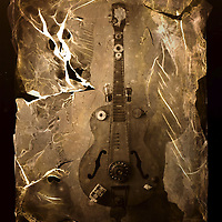 A homemade guitar on a textured background