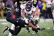 NEW ORLEANS, LA - NOVEMBER 13:  Mark Ingram #22 of the New Orleans Saints is tackled by Billy Winn #97 of the Denver Broncos at Mercedes-Benz Superdome on November 13, 2016 in New Orleans, Louisiana.  (Photo by Wesley Hitt/Getty Images) *** Local Caption *** Mark Ingram; Billy Winn