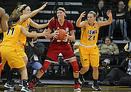 February 11 2013: Nebraska Cornhuskers forward Emily Cady (23) tries to keep the ball away from Iowa Hawkeyes guard Jaime Printy (24) and Iowa Hawkeyes guard Melissa Dixon (21) during the first half of the NCAA women's basketball game between the Nebraska Cornhuskers and the Iowa Hawkeyes at Carver-Hawkeye Arena in Iowa City, Iowa on Monday, February 11 2013.