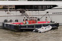 © Licensed to London News Pictures. 29/03/2018. London, UK. Gas cannisters and heaters next to the 220ft custom luxury superyacht, 'Global' moored at Butlers Wharf near Tower Bridge during a London visit. Previously named, Kismet during her last central London visit, she underwent a refit which saw her moved up 51 places in Boat International's list of top 200 largest super yachts in the world, boasting numerous luxuries such as a helipad, cinema and jacuzzi. Believed to be owned by Fulham Football Club chairman, Shahid Khan, Global can be chartered for an estimated £1m per week. Powered by 2 Caterpillar (3512 B) 2,038hp diesel engines and propelled by her twin screws propellers, Global is capable of a top speed of 15.5 knots, and comfortably cruises at 14 knots.. Photo credit: Vickie Flores/LNP