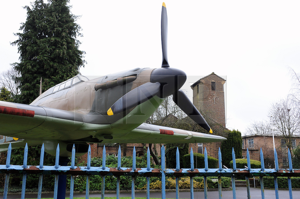 © Licensed to London News Pictures. 05/01/2015<br /> Hurricane Fighter plane.<br /> St George's RAF chapel in Biggin Hill is facing closure after the Ministry of Defence decided to pull funding. <br /> The chapel, along A233 Main Road,Biggin Hill,Kent could close from March next year if replacement funding is not found. <br />  The names of 454 servicemen operating from Biggin Hill who lost their lives in World War II are commemorated in the church. <br /> Also flanking the entrance are two full size replicas of a Spitfire and a Hurricane 'gate guardians'. <br /> The Chapel also has  Stained glass windows depicting a variety of aviation scenes some designed by Hugh Easton. <br /> <br /> <br /> <br /> (Byline:Grant Falvey/LNP)