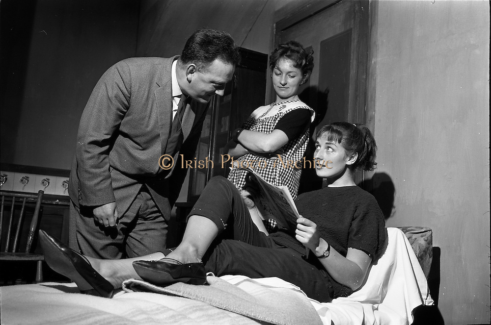 """20/09/1963<br /> 09/20/1963<br /> 20 September 1963<br /> Dublin Drama Festival production of """"Roots"""" at Damer Theatre for Gael Linn.<br /> """"Roots"""" by Arnold Wesker of London translated into Irish by Padraic Ó Gaora was the first production of a Wesker play in Ireland, produced by Seamus Pair Ceir, with sets by Noel O'Brien. Picture shows a scene from the production (l-r): Barra Ó h-Uallachain, (as Stan Mann); Aine Ní Mhuiri (as Jenny Beales) and Maire Ní Neill (as Beatie Bryant)."""