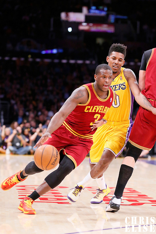 14 January 2014: Cleveland Cavaliers shooting guard Dion Waiters (3) drives past Los Angeles Lakers small forward Nick Young (0) during the Cleveland Cavaliers 120-118 victory over the Los Angeles Lakers at the Staples Center, Los Angeles, California, USA.