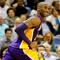 Dec 5, 2012; New Orleans, LA, USA; Los Angeles Lakers shooting guard Kobe Bryant (24) smiles after hitting a shot in the fourth quarter of a game against the New Orleans Hornets at the New Orleans Arena. The Lakers defeated the Hornets 103-87.  Mandatory Credit: Derick E. Hingle-USA TODAY Sports