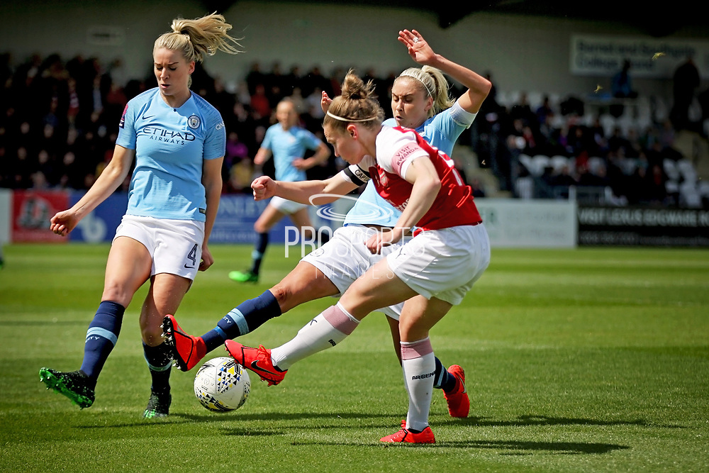 Arsenal midfielder Kim Little (10) has a shot blocked by Manchester City defender Steph Houghton (6) during  the FA Women's Super League match between Arsenal Women FC and Manchester City Women at Meadow Park, Borehamwood, United Kingdom on 12 May 2019.